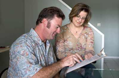 man and woman filling out a form on a clipboard